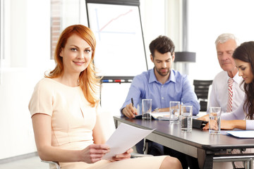 Beautiful businesswoman at meeting