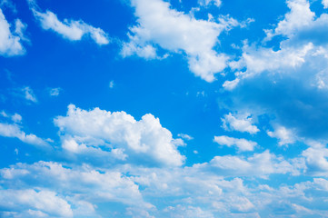 Background blue sky with white cumulus clouds