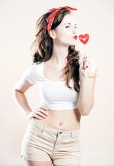 Pretty young woman pin up girl sending kiss