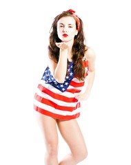 Pin up girl wrapped in american flag sending kiss