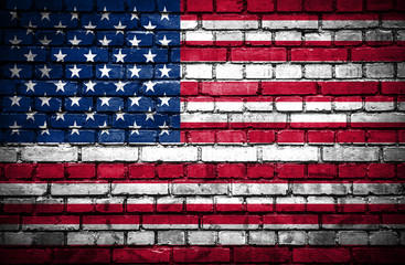 Brick wall with painted flag of United States of America