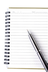 Lined notebook and pen