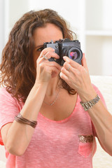 Mature woman taking pictures