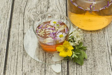 cup of herbal tea with flowers