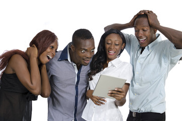 Four african young people with tablet PC having fun