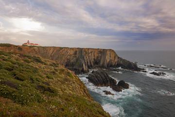 The lighthouse on the headland on the Atlantic coastline.