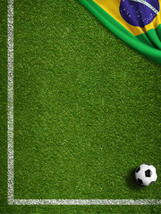 Soccer field with ball and flag of Brazil