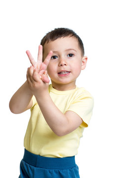 child boy show the number three with hands