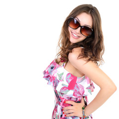 Beautiful cheerful confident young woman in sunglasses, over a w