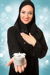 Arabic woman, holding Christmas present box.