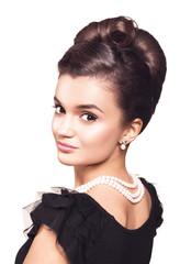 portrait of beautiful brunette woman wearing pearl jewelry