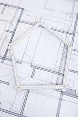 Folding Ruler In House Shape On Blueprint