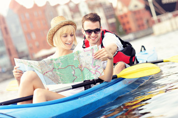 Young couple with a map in a canoe
