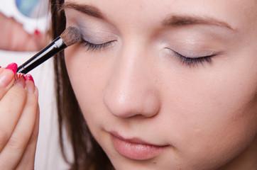 Beautiful girl paint eyelids