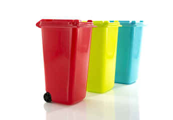red blue and yellow green garbage bin