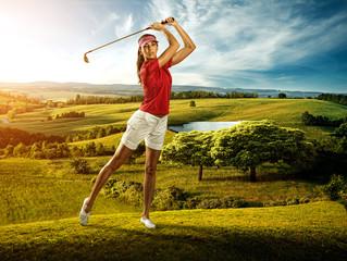 Woman golfer hitting the ball on the  scenery  beautiful