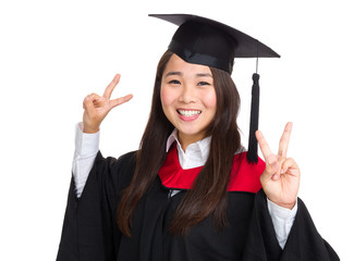Happy girl with graduation gown