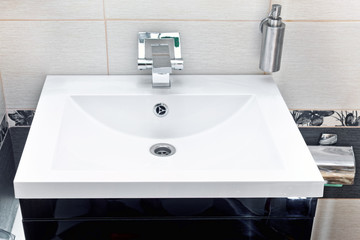 White sink and soap dispenser.
