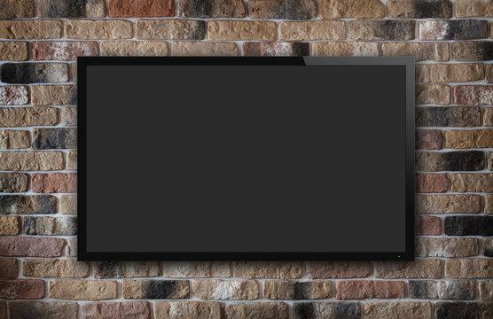 TV display on brick wall