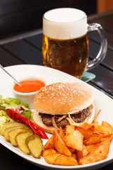 burger with mug of beer