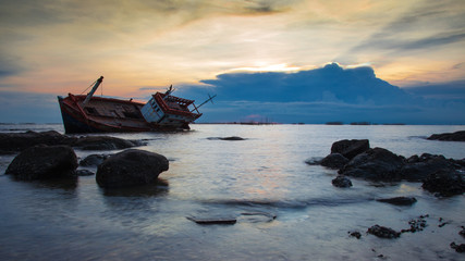 Acrylic Prints Shipwreck crash boat on sea during sunset