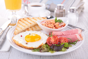 breakfast with egg, bacon and bean