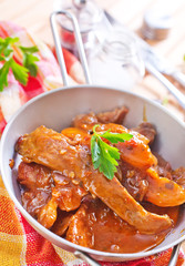 fried meat with tomato sauce