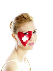 girl with swiss flag face painting