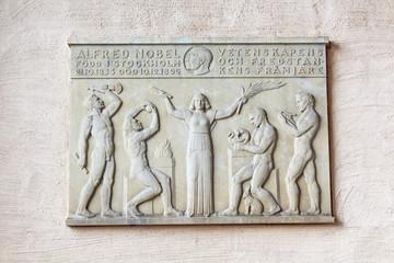 Nobel memorial plaque on the wall in Stockholm City Hall, Sweden