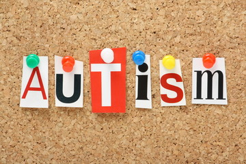 The word Autism on a cork notice board