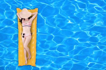Woman floating on a pool mattress 1