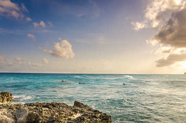 Sunset in Barbados with Surfers waiting for the Right Wave