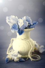 bouquet of irises in a wooden vase