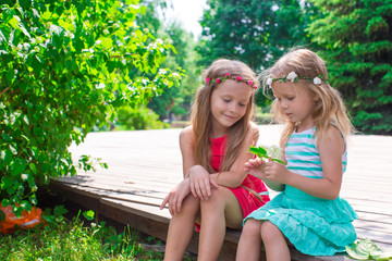 Happy adorable girls enjoy summer day play in the park