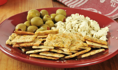 Feta cheese with crackers and olives