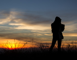 Photographer silhouette in outdoor with sunset.