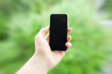 Mobiltelefon in der Hand