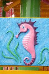 Cartoon of seahorse.