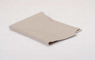 Natural Linen Napkin On White Painted Wood Background