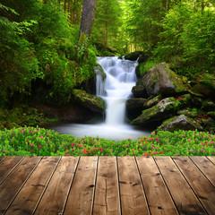 Deurstickers Watervallen Beautiful waterfall in green forest
