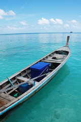 Wooden boat floating on clear water