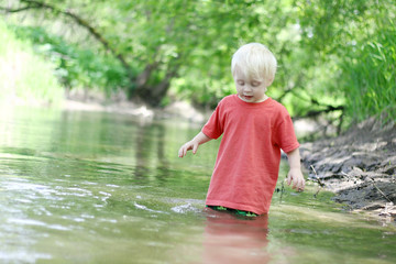 Young Child Playing Outside in the River