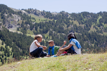 Family relaxing in the mountain