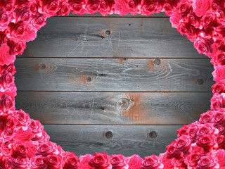 frame from red roses and the boards