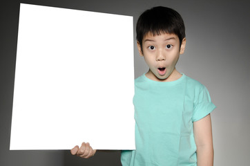 Asian cute boy with big white  blank plate  for add your text .