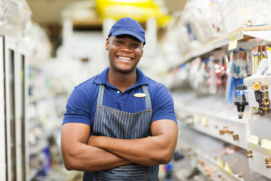 afro american hardware worker with arms crossed