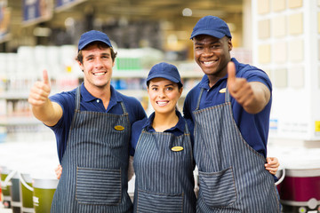 hardware store workers giving thumbs up