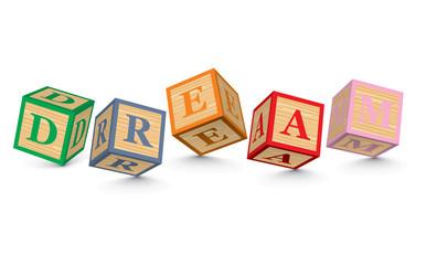 Word DREAM written with alphabet blocks