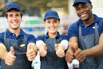 group of supermarket workers thumbs up