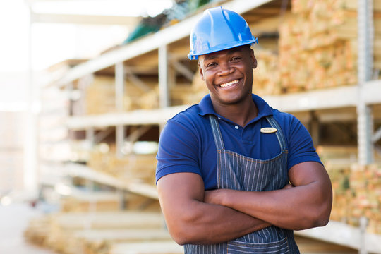 african male warehouse worker with arms crossed